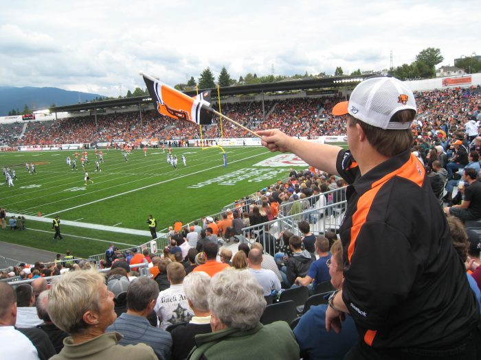 2010 Standing cheering on his CFL team